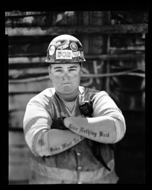 """Jamie Dicey, heavy equipment operator working on the tunnel boring project """"Brenda"""" near Northgate Mall in Seattle.  Photographed April 29, 2015 for the Women in the Trades portrait series on a 4x5 camera with black and white film."""